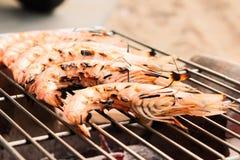 Grilled fresh prawns on flaming seafood Stock Photo