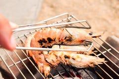 Grilled fresh prawns on flaming seafood Royalty Free Stock Photos