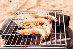 Grilled fresh prawns on flaming seafood Stock Photos