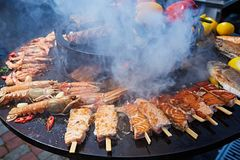 Grilled fresh seafood: prawns, fish, octopus, oysters food background Barbecue Cooking BBQ. Seafood stock photography