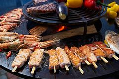 Grilled fresh seafood: prawns, fish, octopus, oysters food background Barbecue Cooking BBQ. Seafood royalty free stock image