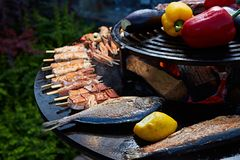 Grilled fresh seafood: prawns, fish, octopus, oysters food background Barbecue Cooking BBQ. Seafood royalty free stock photography
