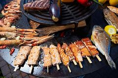 Grilled fresh seafood: prawns, fish, octopus, oysters food background Barbecue Cooking BBQ. Seafood stock photo