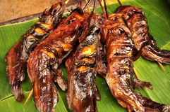 Grilled fresh Walking catfish with herbs and lemon. On banana leaf Royalty Free Stock Images