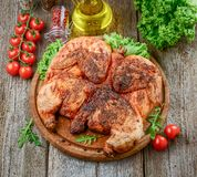 Grilled fried roast Chicken tobacco on cutting board stock images