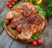 Grilled fried roast Chicken tobacco on cutting board stock photography