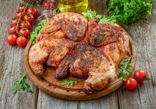 Grilled Fried Roast Chicken Tobacco On Cutting Board Stock Image