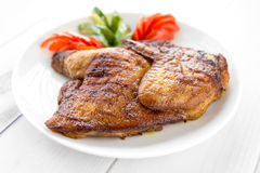 Grilled fried roast Chicken tobacco. With vegetables Stock Photo