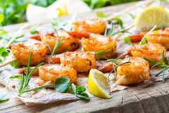 Grilled fried Shrimps Prawns on wooden skewers with spices Royalty Free Stock Photo