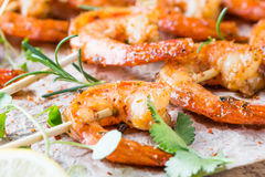 Grilled fried Shrimps Prawns on wooden skewers with spices Royalty Free Stock Image