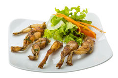 Grilled frog legs Stock Photos