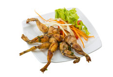 Grilled frog legs Royalty Free Stock Images