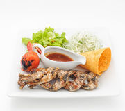 Grilled frogs with crisp loaf and spicy sauce Royalty Free Stock Images