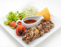 Grilled frogs with crisp loaf and spicy sauce Royalty Free Stock Image