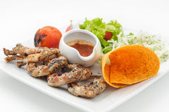 Grilled frogs with crisp loaf and spicy sauce Royalty Free Stock Photography