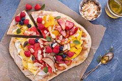 Grilled fruit pizza with honey. Grilled fruit pizza with cream cheese, honey and coconut best summer dessert royalty free stock photos