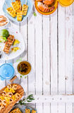 Grilled Fruit and Seafood Dishes on Wooden Table Stock Image