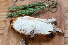 Grilled gammon steak on a wooden board Royalty Free Stock Photos