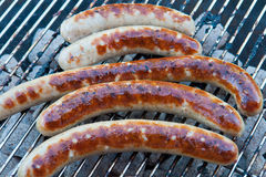 Grilled German sausage hot dog wurst BBQ Royalty Free Stock Images