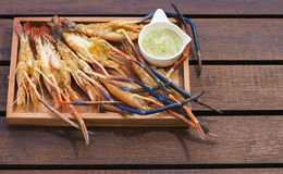 Grilled Giant River shrimp. On wood plates ,River prawn grilled on charcoal stove Stock Photos