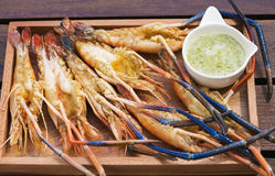Grilled Giant River shrimp. On wood plates ,River prawn grilled on charcoal stove Royalty Free Stock Images