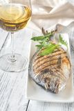 Grilled gilt-head bream. On the plate stock photography