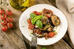Grilled glazed eggplants on black background, top view, copy space. royalty free stock photography