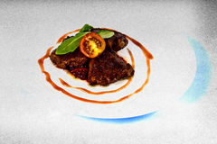 Grilled goose liver with red onion Stock Images