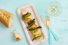 Grilled green asparagus skewers with salmon Stock Image