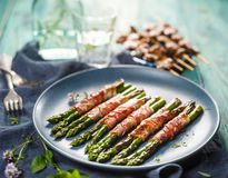 Grilled green asparagus wrapped with bacon Stock Photo