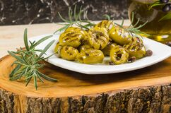 Grilled Green Olives On Plate Stock Images