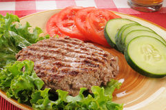 Grilled ground beef patty with vegetables Royalty Free Stock Photography