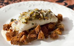 Grilled Hake with toast bread and picata. Royalty Free Stock Image