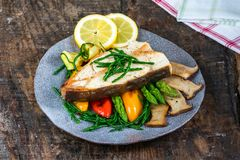 Grilled halibut steak with vegetables stock photography