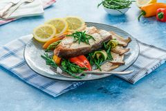 Grilled halibut steak with vegetables royalty free stock photos