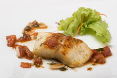 Grilled halibut with tomato concasse. Stock Photos