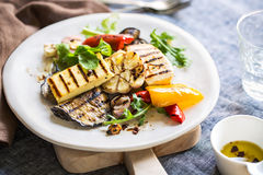 Grilled Halloumi with aubergine and pepper salad Stock Images
