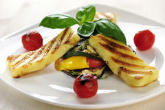 Grilled Halloumi cheese on grilled vegetables with basil Royalty Free Stock Photo