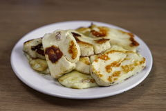 Grilled halloumi cheese on the plate. On the wooden table Stock Photography