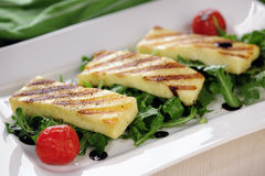 Grilled Halloumi cheese on rocket salad. On aplate Stock Photos