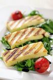 Grilled Halloumi cheese on rocket salad. Selective focus Stock Photography