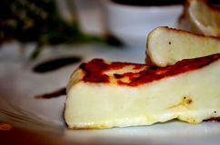 Grilled halloumi cheese with tomatoe pasta Stock Photo