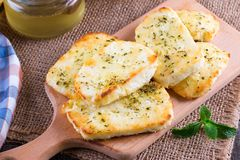 Grilled haloumi cheese with herbs on a cutting board. Grilled haloumi cheese with herbs and honey on a cutting board Royalty Free Stock Image
