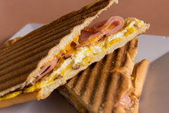 Grilled ham, cheese and egg panini Stock Photography