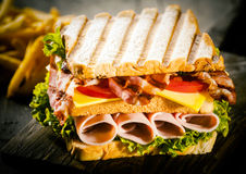 Grilled ham , cheese and salad club sandwich Royalty Free Stock Images