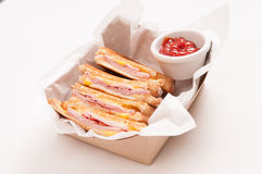 Grilled ham with cheese take out sandwich Stock Photo