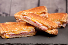 Grilled ham with cheese take out sandwich Royalty Free Stock Image