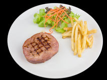 Grilled Ham Steak on a white plate isolated on the black background with clipping path Stock Images
