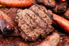 Grilled hambuger and meats Stock Images