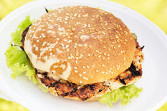 Grilled hamburger with bacon Royalty Free Stock Image